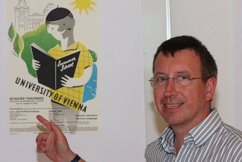 Director Meissel ponting at a poster for one of the first summer programs organized by the SHS