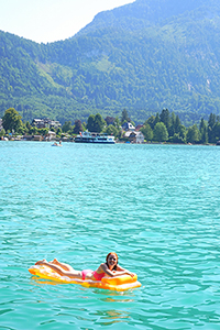 Girl on an air mattress on the lake