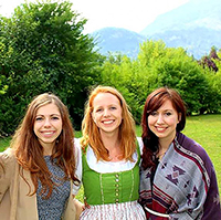 Three Girls in front of green landscape